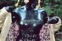 walking-by-the-shadow-of-forest-in-full-rubber-enclosure-rubberhell-10