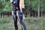 walking-by-the-shadow-of-forest-in-full-rubber-enclosure-rubberhell-32