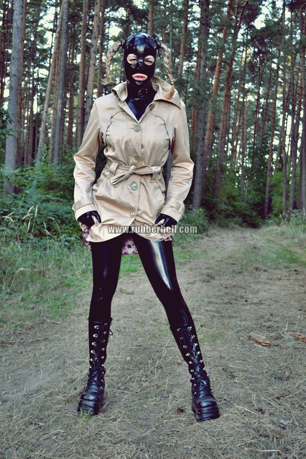 walking-by-the-shadow-of-forest-in-full-rubber-enclosure-rubberhell-01
