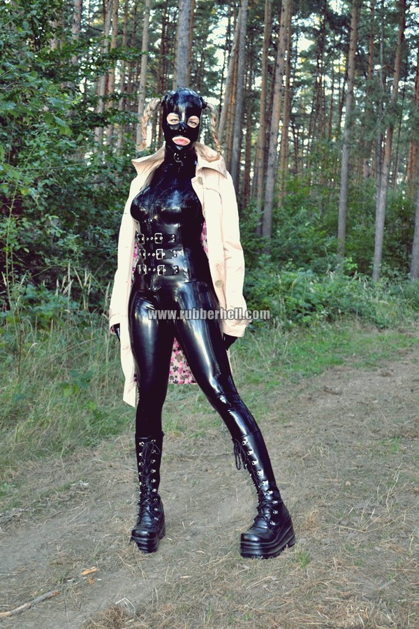 walking-by-the-shadow-of-forest-in-full-rubber-enclosure-rubberhell-06