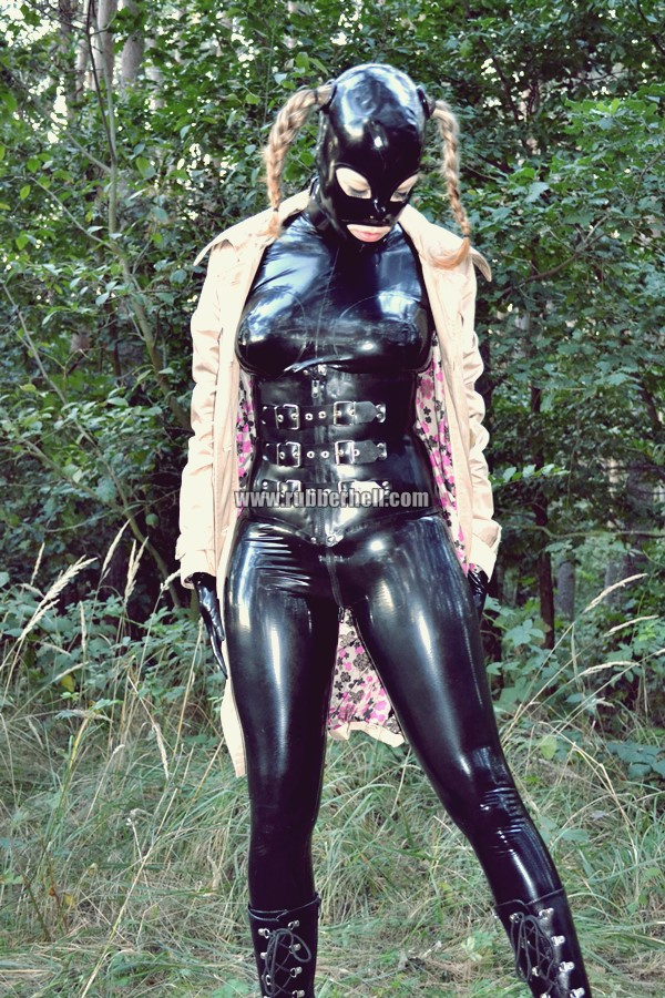 walking-by-the-shadow-of-forest-in-full-rubber-enclosure-rubberhell-15