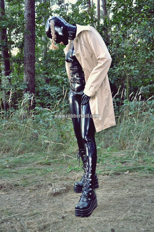 walking-by-the-shadow-of-forest-in-full-rubber-enclosure-rubberhell-20