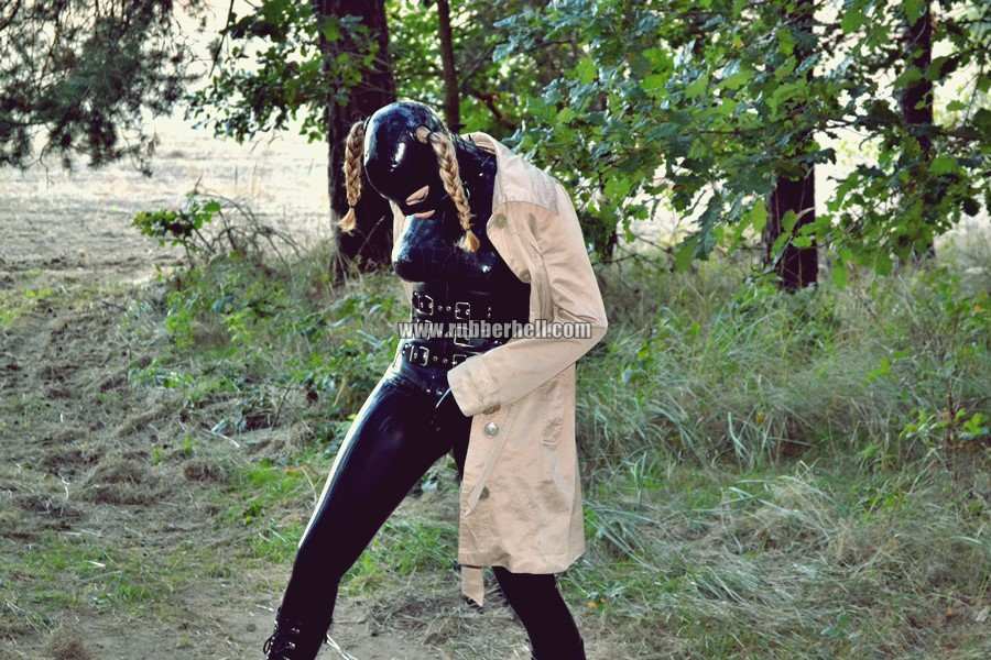 walking-by-the-shadow-of-forest-in-full-rubber-enclosure-rubberhell-25