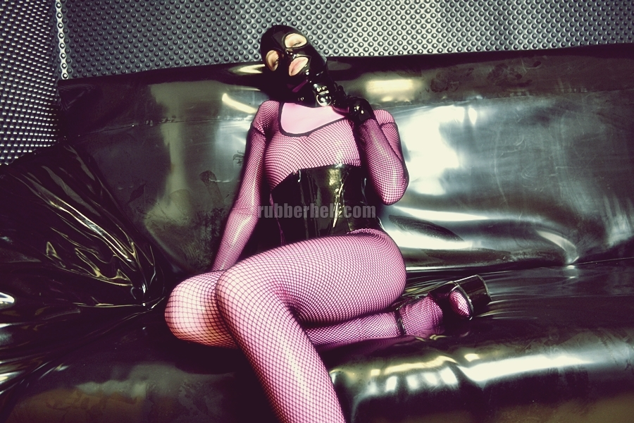 pink-latex-catsuit-covered-in-fishnet-05