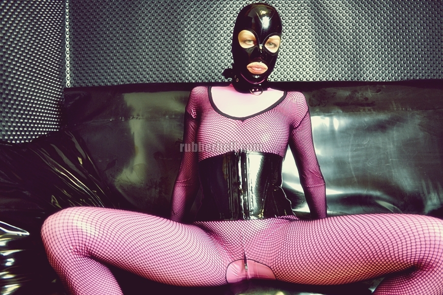 pink-latex-catsuit-covered-in-fishnet-06