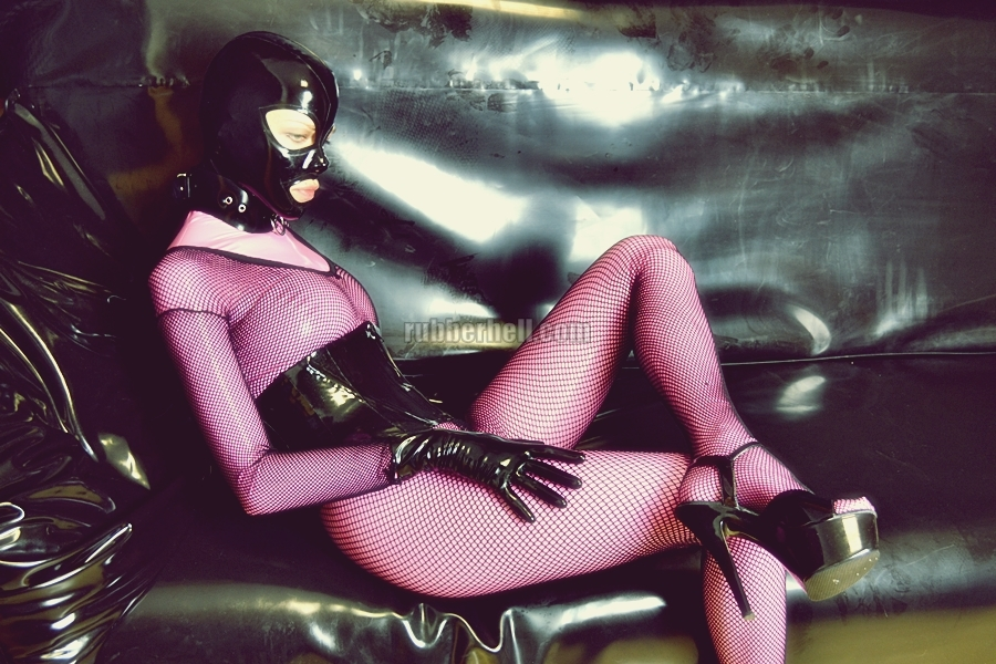 pink-latex-catsuit-covered-in-fishnet-14