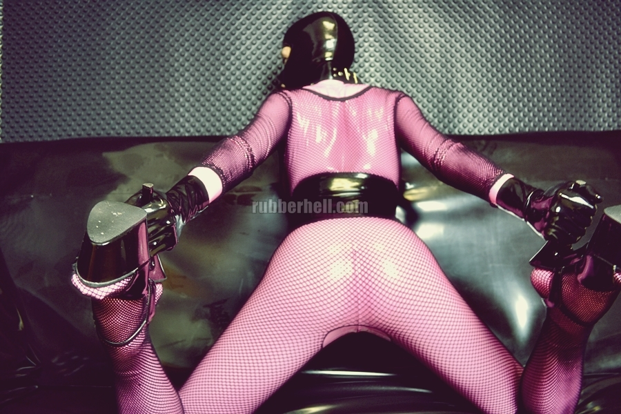 pink-latex-catsuit-covered-in-fishnet-19