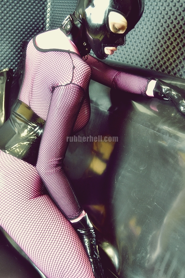 pink-latex-catsuit-covered-in-fishnet-22
