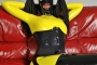 yellow-black-latex-doll-on-leather-sofa-4-03