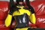 yellow-black-latex-doll-on-leather-sofa-4-04