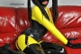 yellow-black-latex-doll-on-leather-sofa-4-13