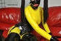 yellow-black-latex-doll-on-leather-sofa-4-16