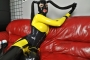 yellow-black-latex-doll-on-leather-sofa-4-19