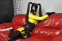 yellow-black-latex-doll-on-leather-sofa-4-21