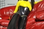 yellow-black-latex-doll-on-leather-sofa-4-22