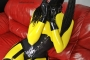yellow-black-latex-doll-on-leather-sofa-4-25