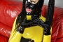 yellow-black-latex-doll-on-leather-sofa-4-26
