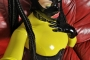 yellow-black-latex-doll-on-leather-sofa-4-32