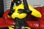 yellow-black-latex-doll-on-leather-sofa-4-40