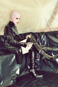 pink-and-black-dolly-in-latex-catsuit-on-pvc-sofa