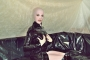 pink-and-black-dolly-in-latex-catsuit-on-pvc-sofa-19