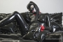 black_catsuit_doll_rubber_bed_040