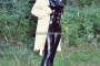 walking-by-the-shadow-of-forest-in-full-rubber-enclosure-rubberhell-08
