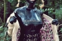 walking-by-the-shadow-of-forest-in-full-rubber-enclosure-rubberhell-12