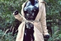 walking-by-the-shadow-of-forest-in-full-rubber-enclosure-rubberhell-17