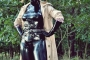 walking-by-the-shadow-of-forest-in-full-rubber-enclosure-rubberhell-31