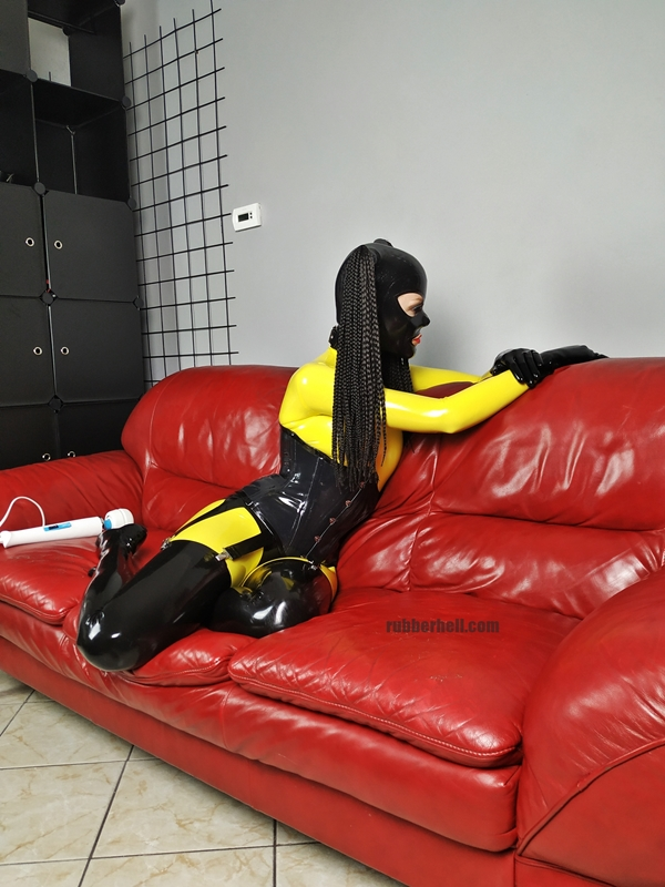 yellow-black-latex-doll-on-leather-sofa-4-20