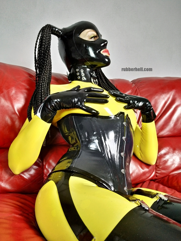 yellow-black-latex-doll-on-leather-sofa-4-30